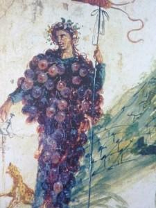 Dioniso rappresentato come grappolo in una pittura di una casa pompeiana.