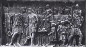 Rilievo sull'arco trionfale dedicato a Traiano, eretto a Benevento tra il 114 e il 117, nel quale si commemora le beneficenza del principe.